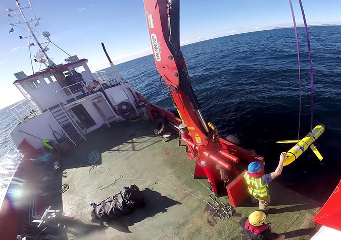 Submarine glider being recovered by Royal Navy personnel off the Outer Hebrides