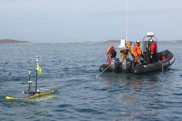 Waveglider being towed into position