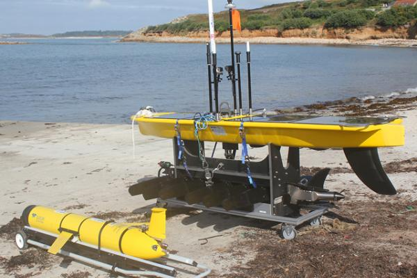 A Slocum Glider and Waveglider on the shore