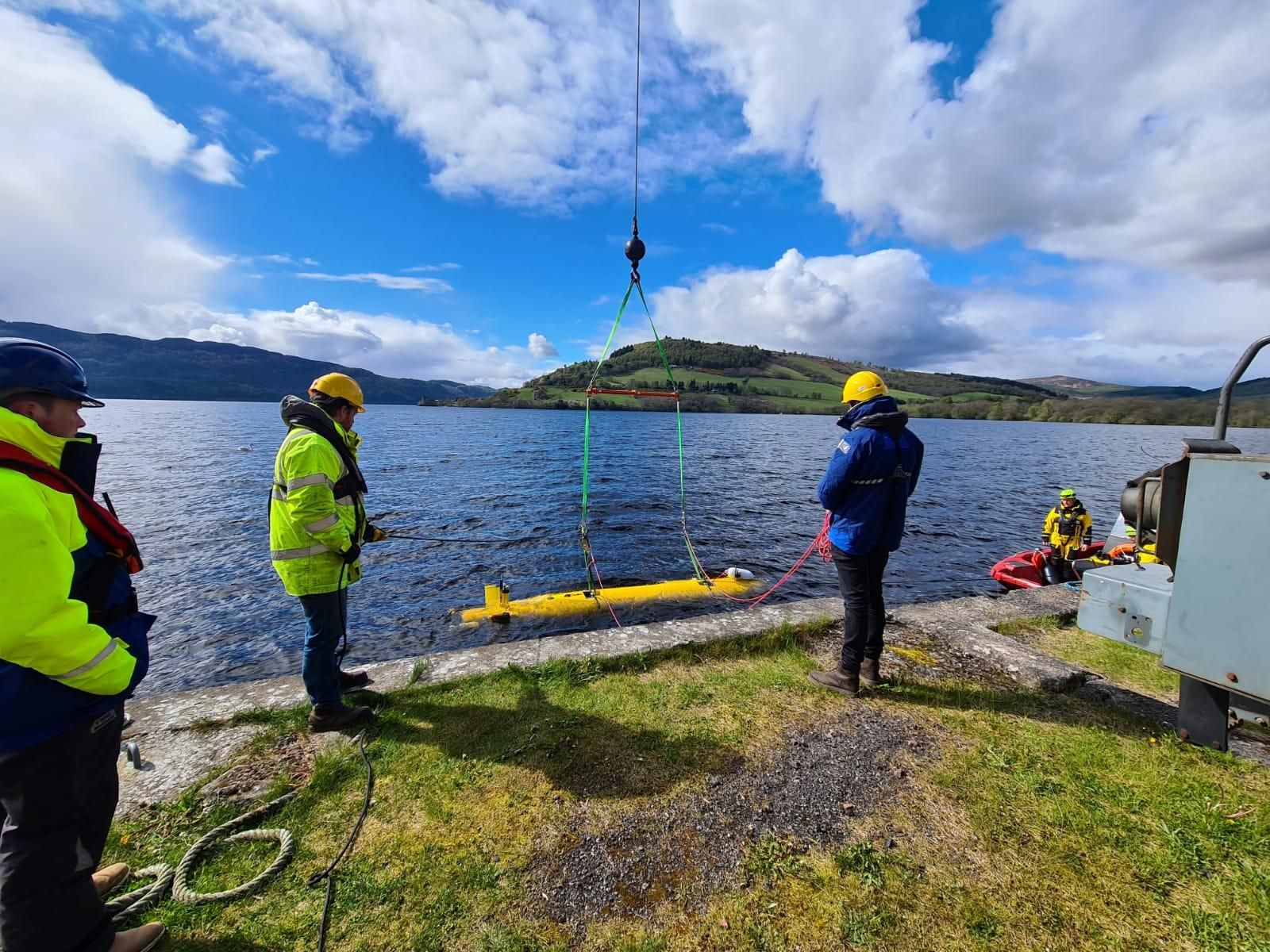 A2KUI being winched into Loch Ness on a sunny day