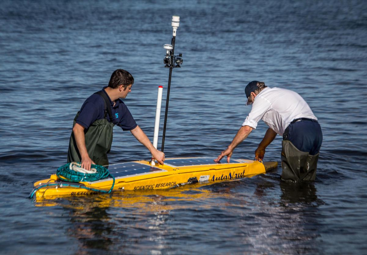 AutoNaut being deployed at Isles of Scilly during MASSMO1, carrying a towed PAM array: Image courtesy of NERC/Dstl/RN